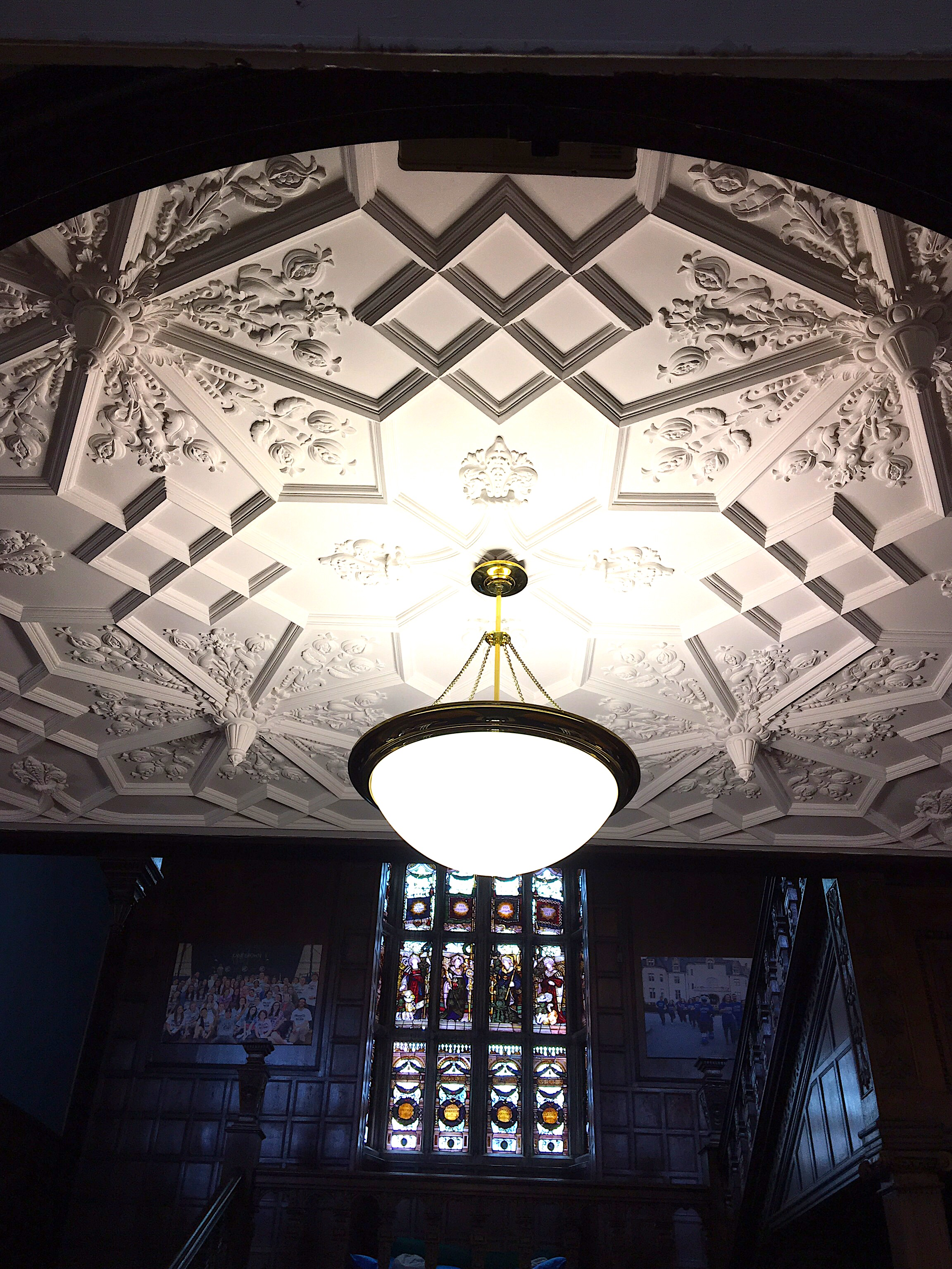 Gothic Revival Style ceiling by Dudley Newton with stained glass windows by Charles Kempe in the background
