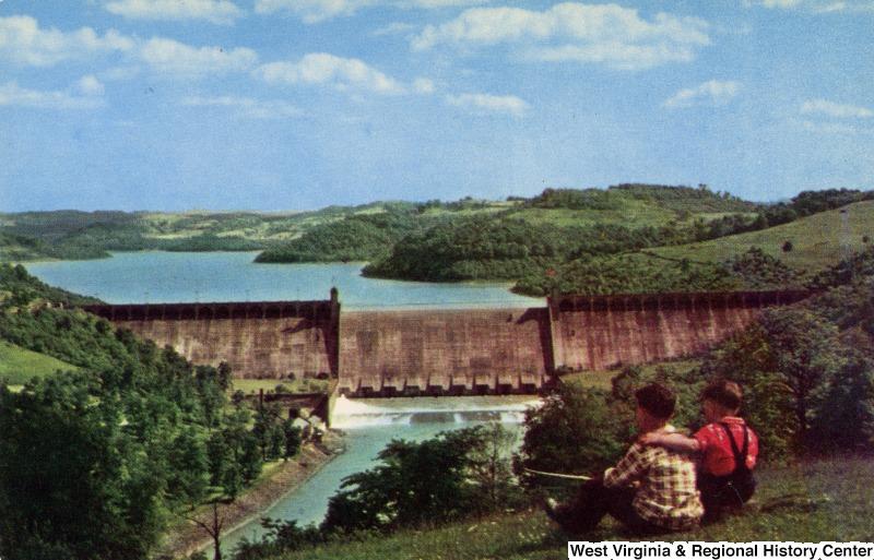 A postcard depicting children enjoying the view of Tygart Lake Dam