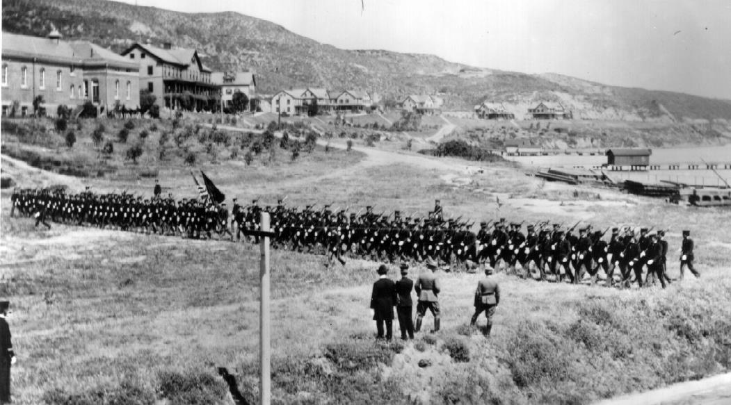 1911 photo of a troop inspection by Brigadier General T. H. Bliss of the 28th and 115th Companies, Coast Artillery Corps.