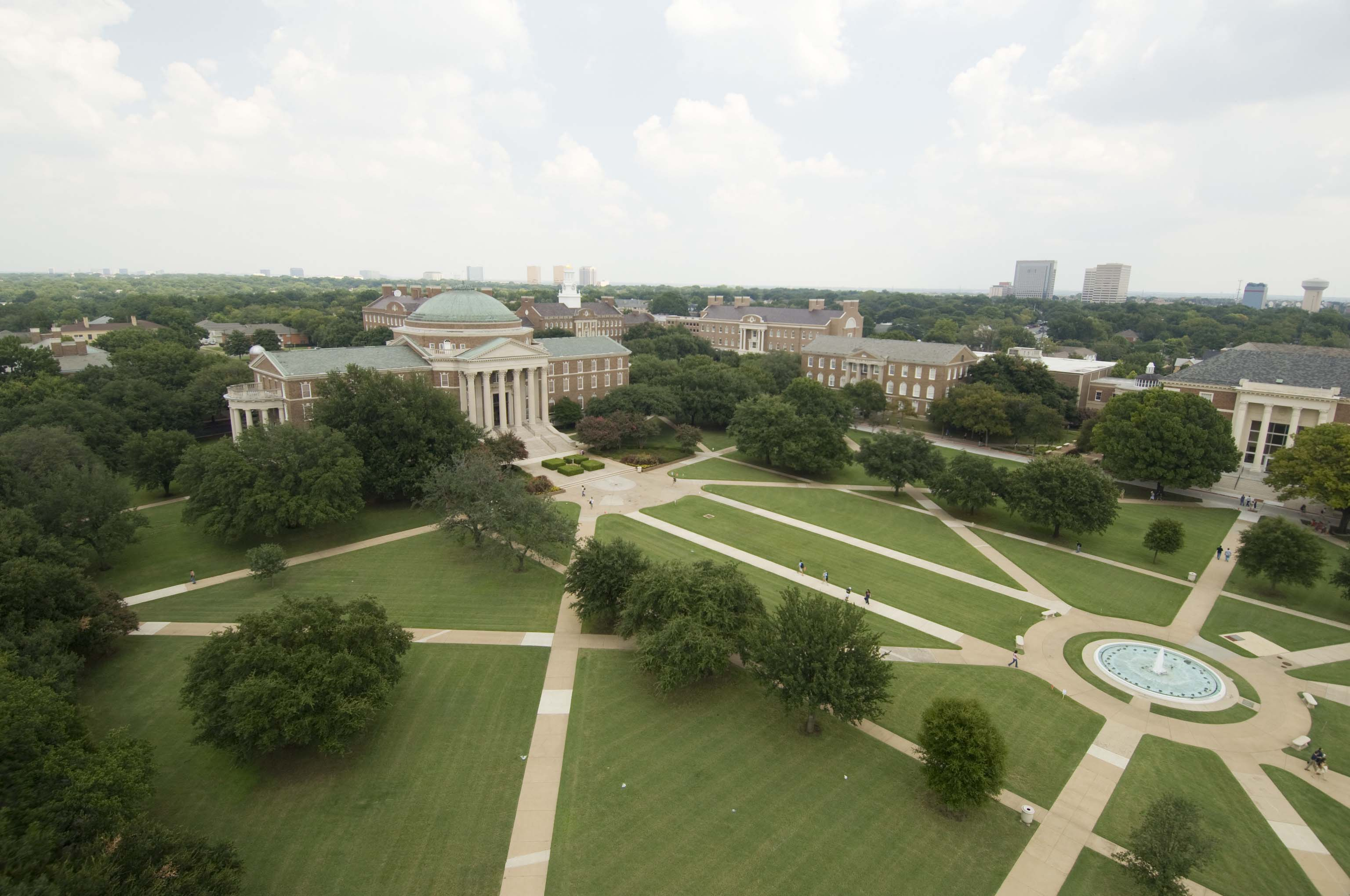 This aerial shot reveals just how large Dallas Hall truly is.  The Dallas skyline can be seen in the background.