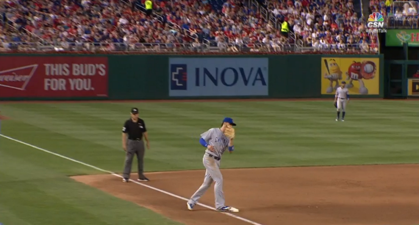 Kris Bryant steps on 3rd base in between innings.