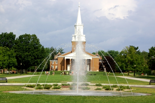 The fountain on the campus green with Wesley Chapel in the background