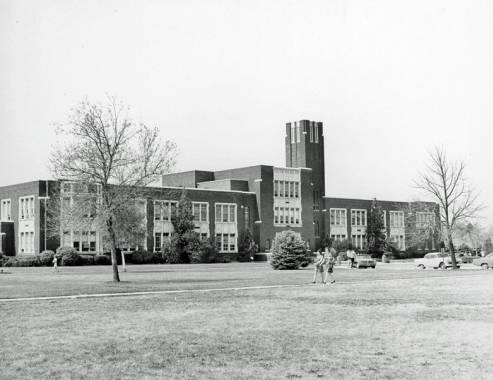 Photo of administration building in 1950s. When the horseshoe driveway was still apart of the layout, cars could park in front of the building.