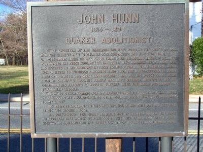The historic marker for John Hunn is located near the Camden Friends Meeting House