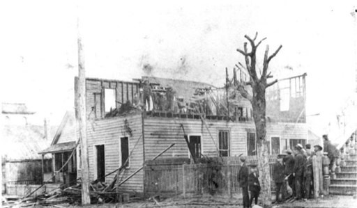 The burned Daily Record after armed white supremacists stormed the business in search of Manly after he fled. 
