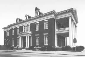 Current official building of the Cape Fear Club, at 206 Chesnut St. This brick Neoclassical Revival structure has been used by the men's club since it was constructed in 1913. (Cape Fear Historical Institute).