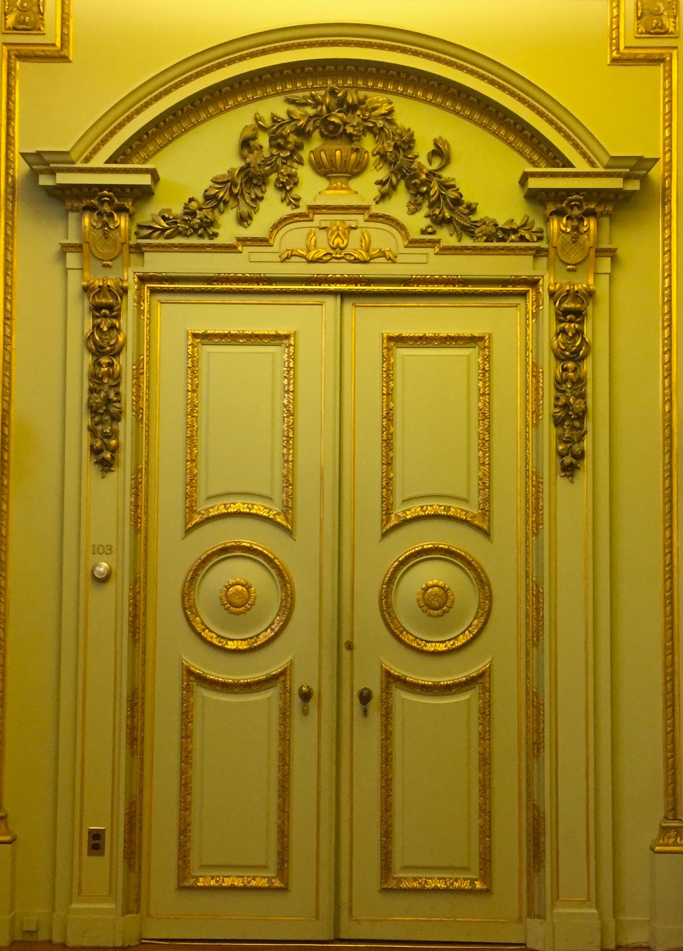 Gilded door on the first floor