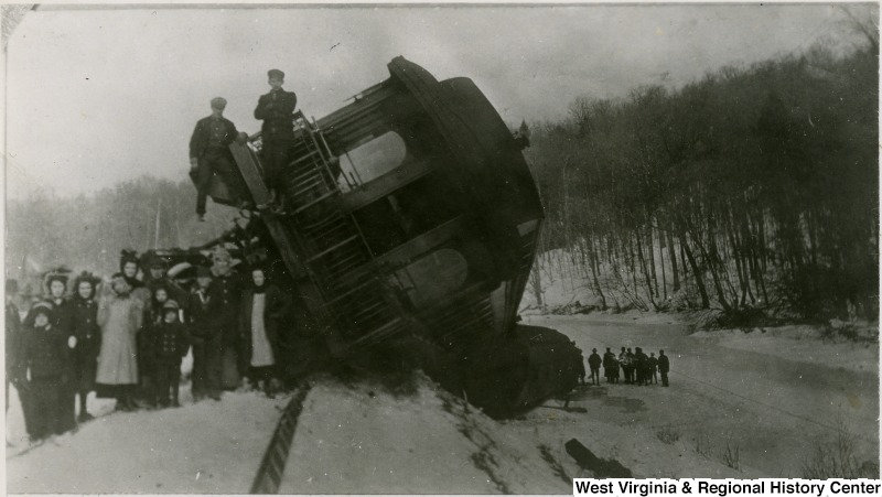 Survivors stand by a Western Maryland train that wrecked in between Thomas and Westernport. 1910 - 1912.