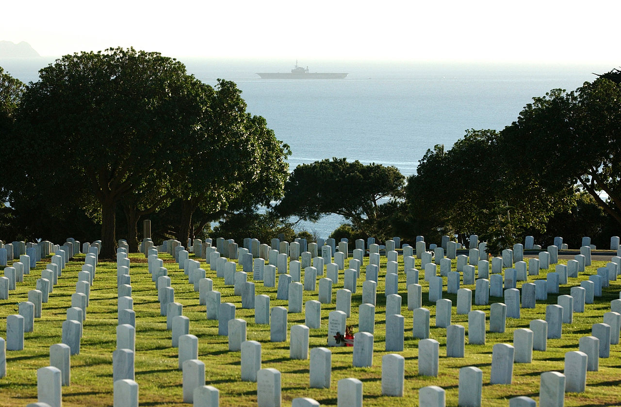 Fort Rosecrans National Cemetery with the Pacific Ocean and the USS Midway in the background