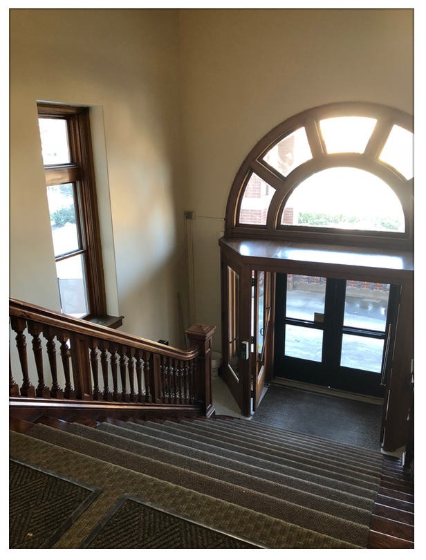 Front entry looking outside, historical handrails