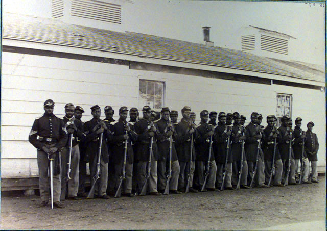 A Photograph of James Adams's unit the 4th U.S.C.T. Infantry Regiment Company E taken at Fort Lincoln, Washington D.C. from U.S. Army Military History Institute, Carlisle Barracks, Full Valley Archive.