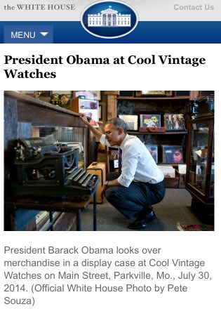 President Barack Obama looks over merchandise in a display case at Cool Vintage Watches on Main Street, Parkville, MO, July 30, 2014. (Official White House photo by Pete Souza)