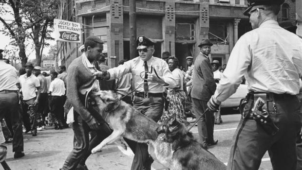 In this iconic image of the movement, a 17-year-old civil rights demonstrator is attacked by a police dog on May 3, 1963 at 16th St and 6th Ave North. Images of the the violence drew worldwide attention.