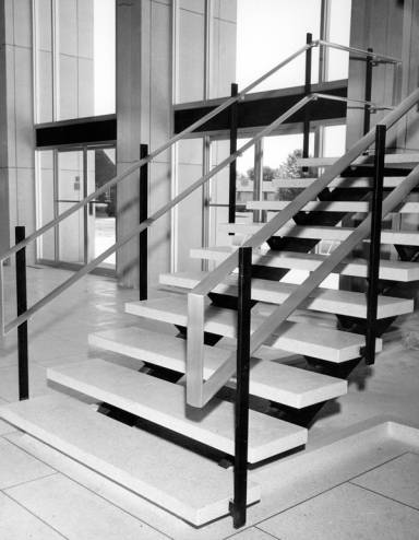 One of two staircases in the main entrance to the library from 1964 to 1993. When the building was remodeled in 1993-95, the entry lobby became the atrium of Albertsons Library.