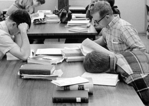 Students studying (and one napping) in the library at Boise College, ca. 1967.