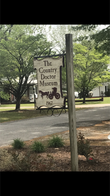 This is the sign that is outside of the museum, just beside the road.