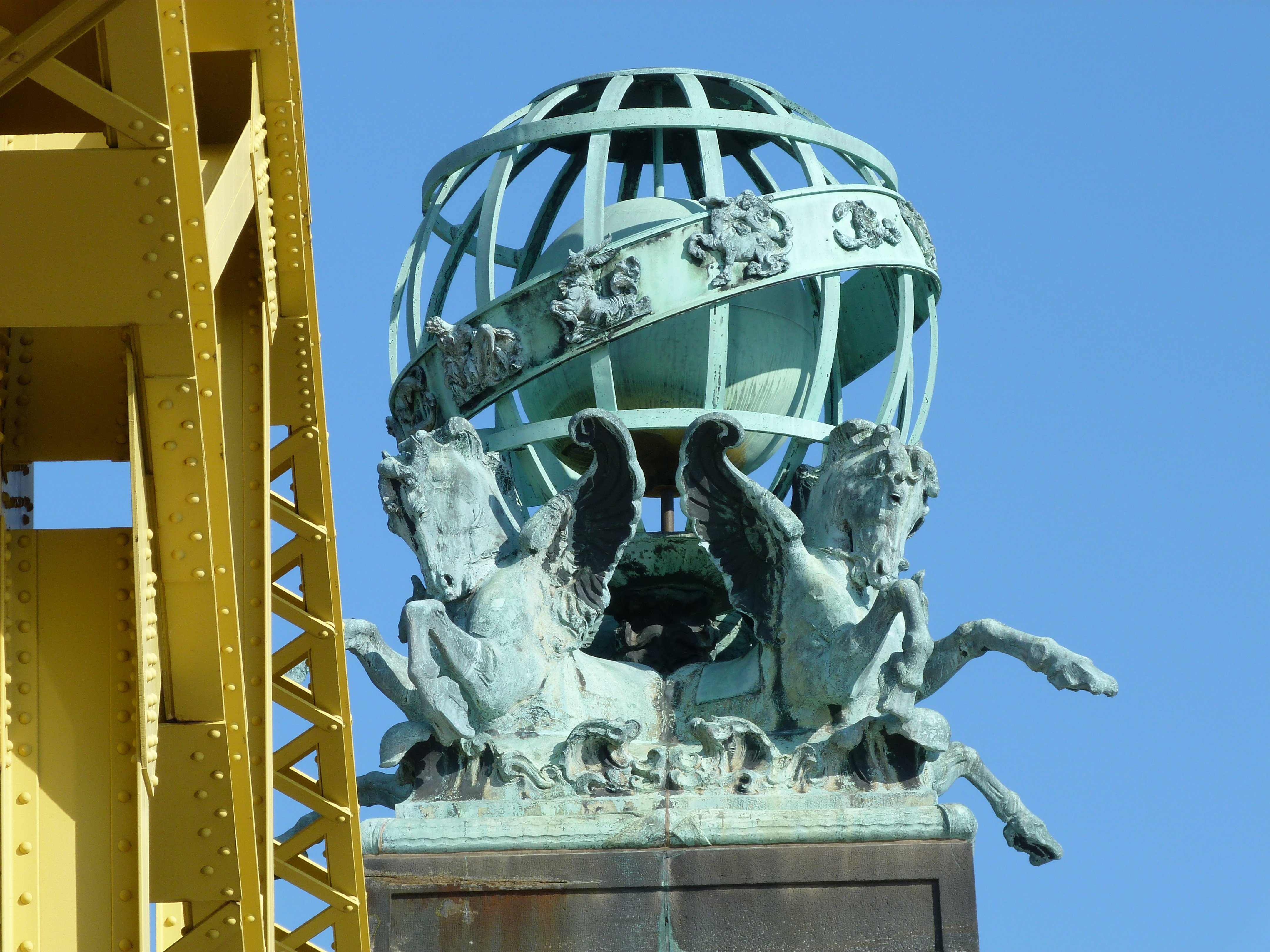 A close-up of one of the four Leo Lentelli sculptures that sit atop each of the bridge's portal towers.