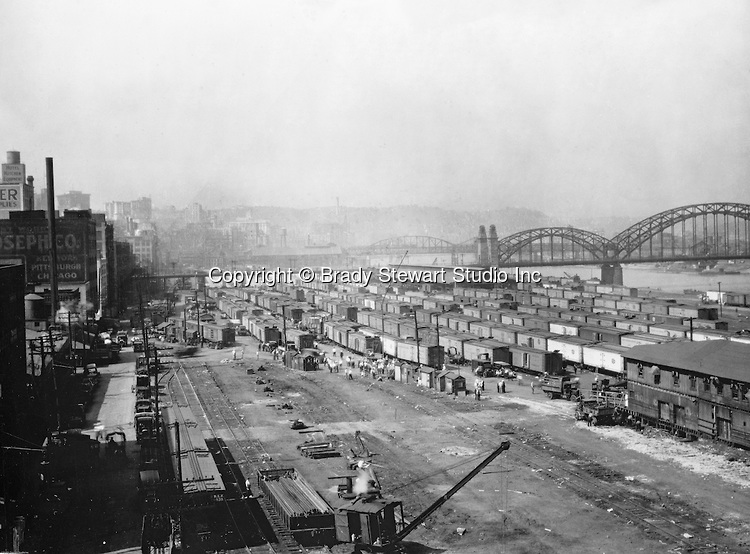 This photo of Pittsburgh's Strip District was taken in 1925 before it became a fashionable neighborhood.  The McCullough Bridge, then known as the 16th Street Bridge, can be seen in the background.