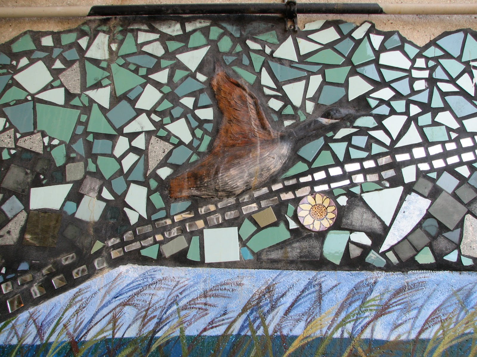 Close up of some of the detail of the mural, waterfowl taking flight. Photo Credit: Jim Bartholomew, 2010.