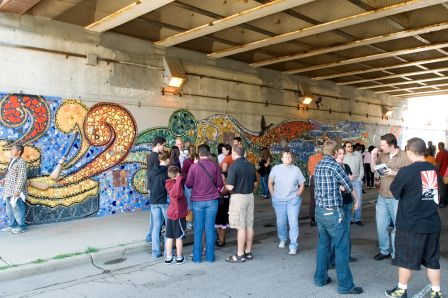 Photo from murals dedication, highlighting the mosaic image of the drum producing music. Photo Credit: Al Candelario / Fydagraphy, 2009 (See Klockars article)