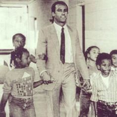 Panthers co-founder Huey Newton with students at the OCS