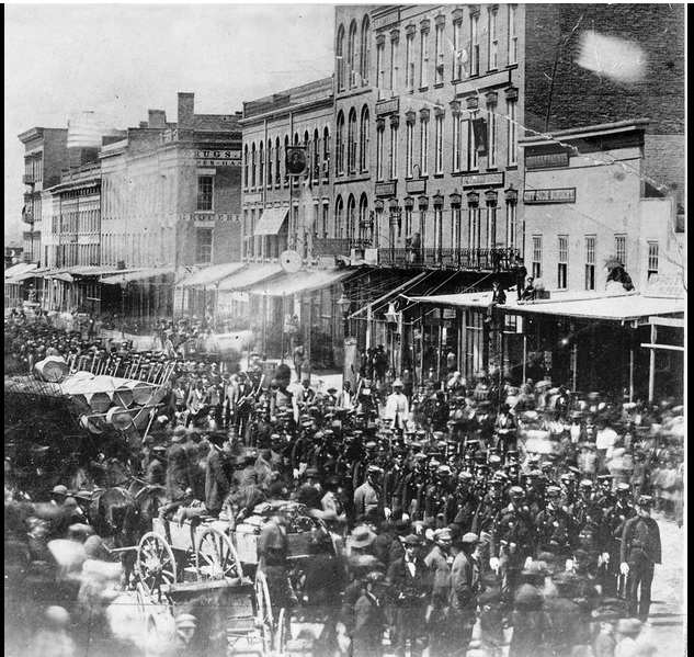 June 1861, Troops marching down East Maumee Street on their way to the battlefront.
