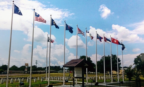 Cemetery with the flags flying in the wind.