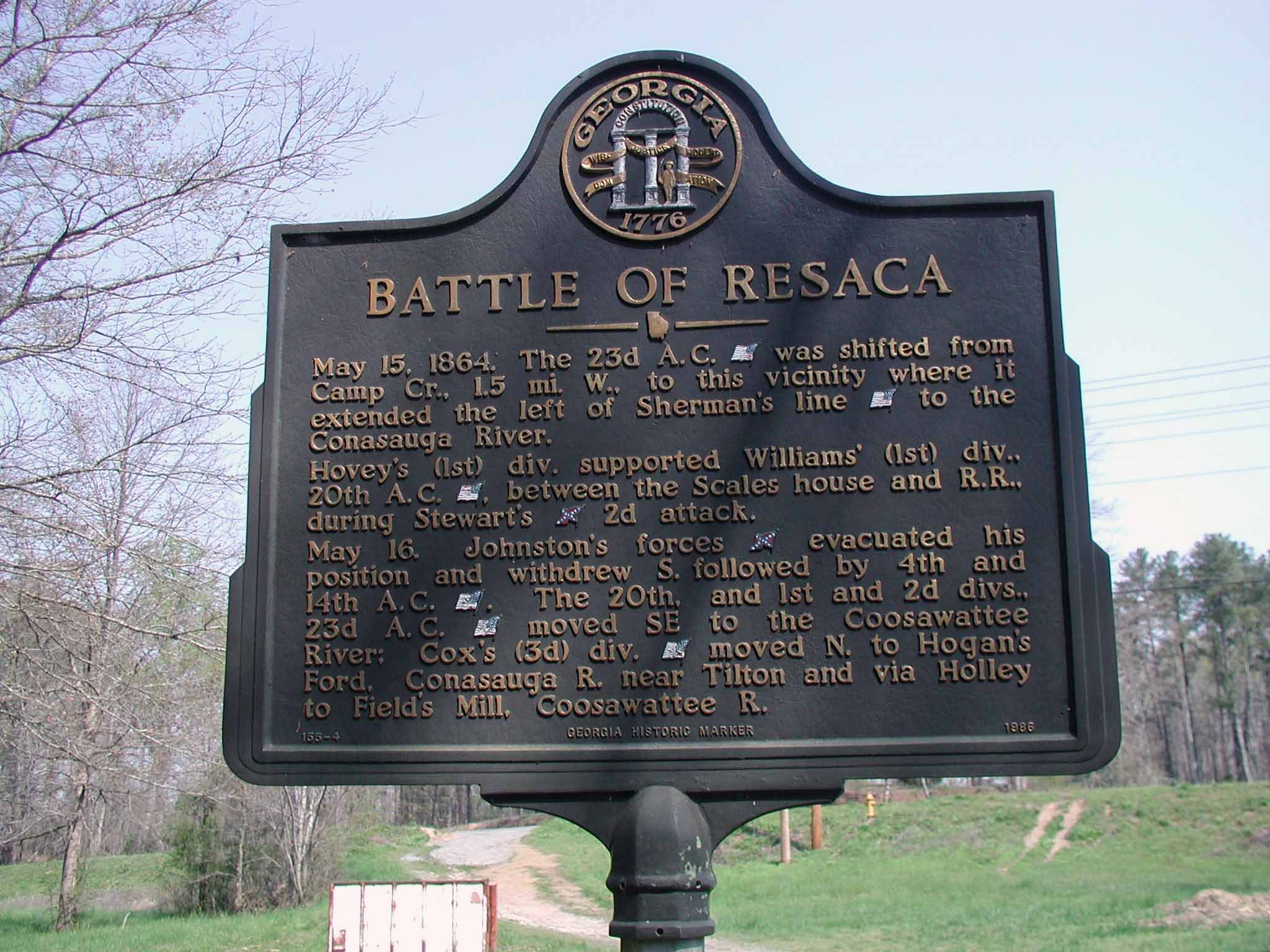 This historical marker was dedicated in 1986 and is located just off the main highway.