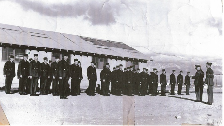 A Marine Corps Company standing in front of their barracks after the Marine took over the airport