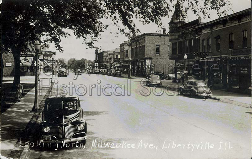 Looking north on Milwaukee Avenue, circa 1940. Lovell's Drug Store/Knight Building on the right.