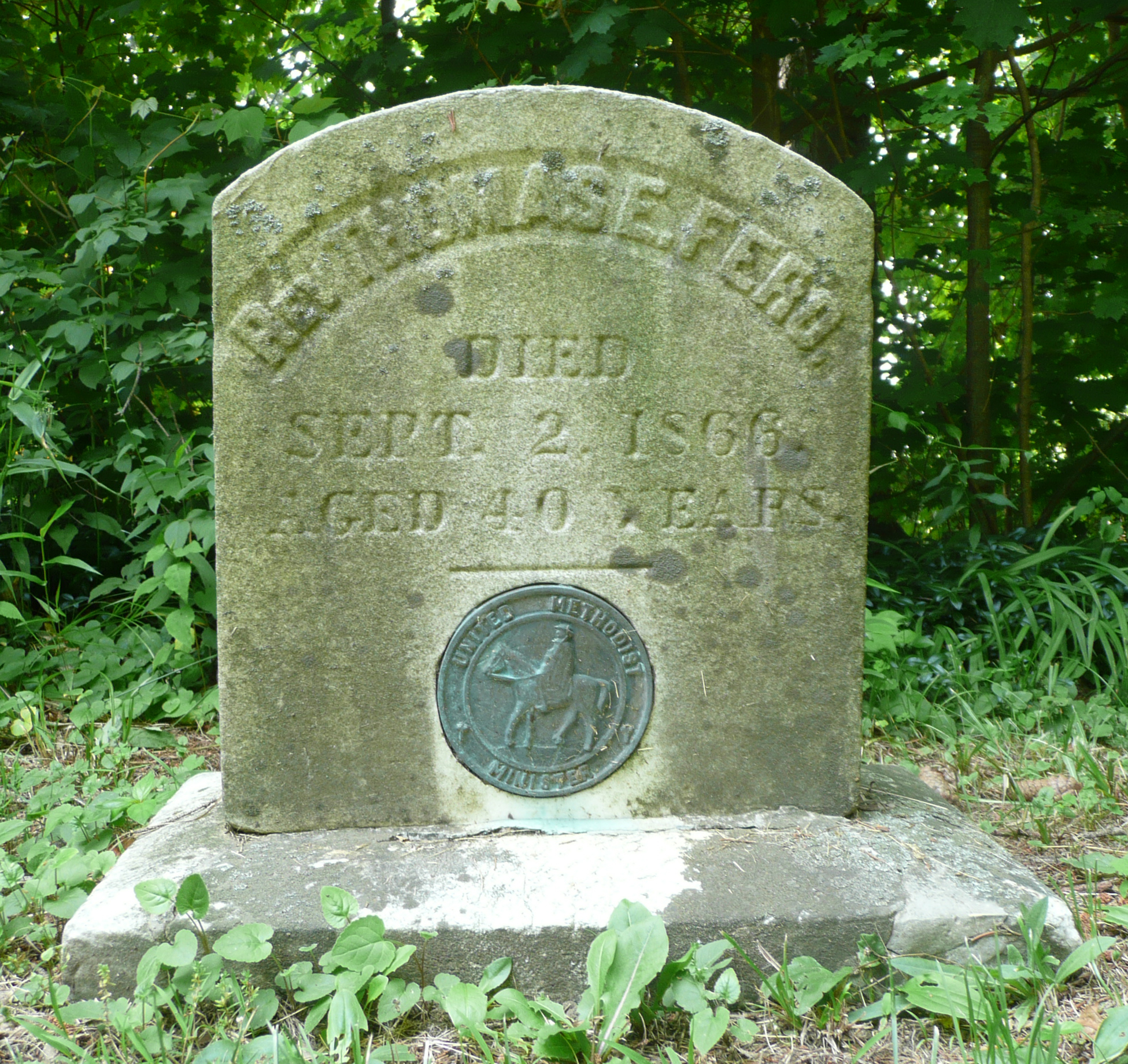 The tombstone of the Reverend Thomas E. Fero contains a medallion indicating that he was a Methodist minister.