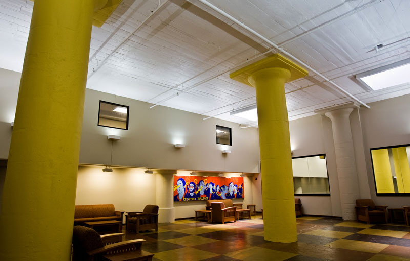 The lobby of Shannon Hall features rotating student art exhibits and its original concrete mushroom columns.