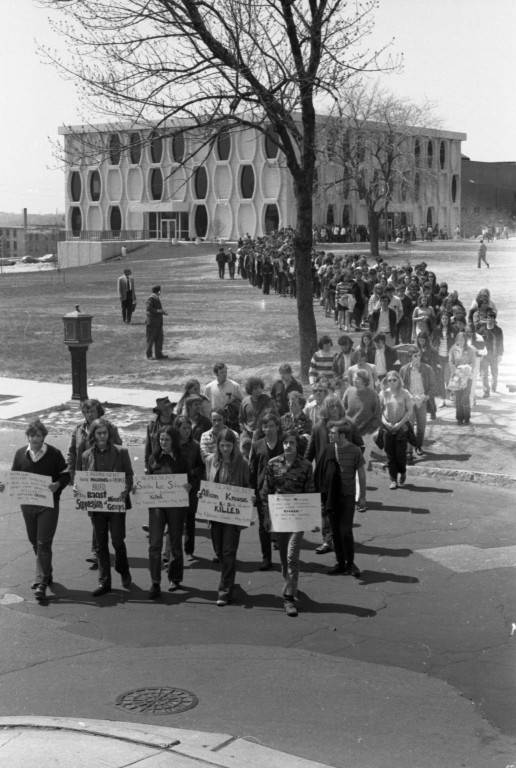 Students protesters form a line departing from Lalumiere Hall, 1970