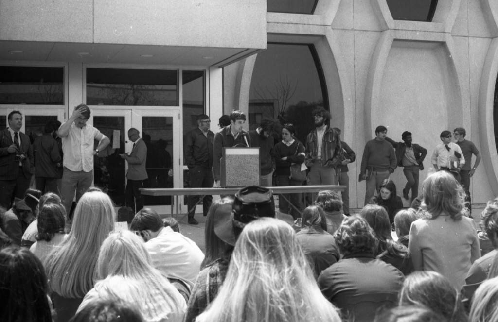 Students listen to a speaker at a Kent State shooting protest event, 1970
