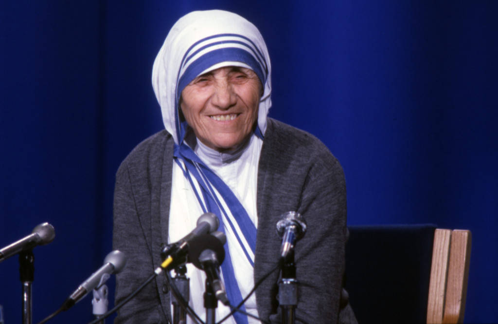 "Mother Teresa stands behind a group of microphones during her time in Milwaukee , June 1981 (""Department of Special Collections and University Archives, Marquette University Libraries, MUA_001135)"