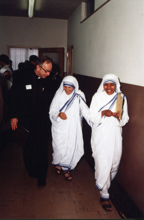 "Rev. Bruce Biever, S.J., escorts Mother Teresa and Sister Fatima, 1981 (""Department of Special Collections and University Archives, Marquette University Libraries, MUA_007692)"