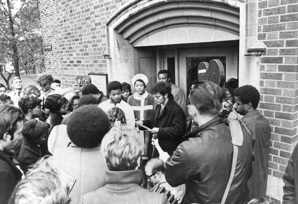 "Students gather in protest outside O'Hara Hall, 1969 (""Department of Special Collections and University Archives, Marquette University Libraries, MUA_014452)"