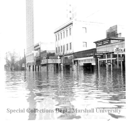 The Roxy and surrounding businesses during the flood of 1937