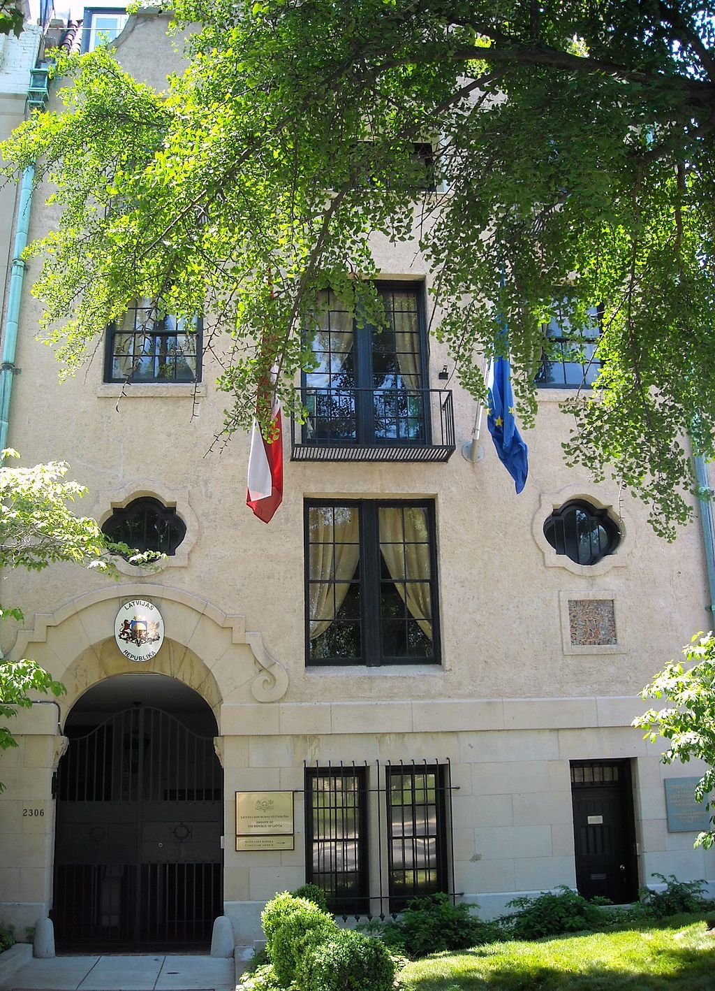 The Latvian chancery is a fine example of Spanish Colonial Revival architecture on Embassy Row, noted by its rounded features and masonry construction.