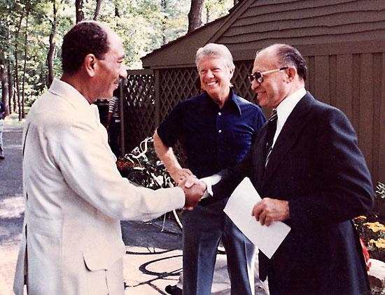 US, Egypt, and Israel meet at Camp David and sign Camp David Accords