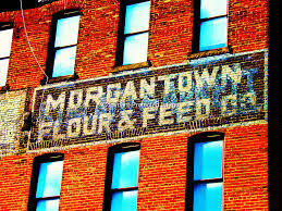 The Updated Morgantown Flour and Feed sign. Originally painted 1921. Repainted 1995