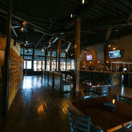 """The current interior of the Kincaid and Arnett Feed and Flour building. Currently used by the """"Morgantown Flour and Feed"""" Restaurant. Cleaning up and reusing the original structure for the building."""