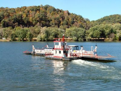 The ferry boat crossing the river.