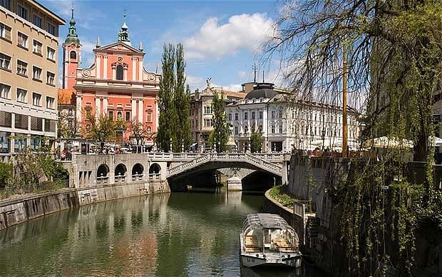 "Pictured is the capital of Slovenia: Ljubljana. The city has a population of 300,000 and can be navigated on foot. There are many cafes and other activities to partake in. Dubbed ""mini-Prague"", you can see the Julian Alps when the skies are clear."