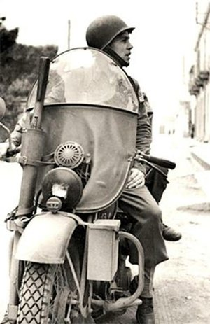 Darby on his classic motorcycle in North Africa