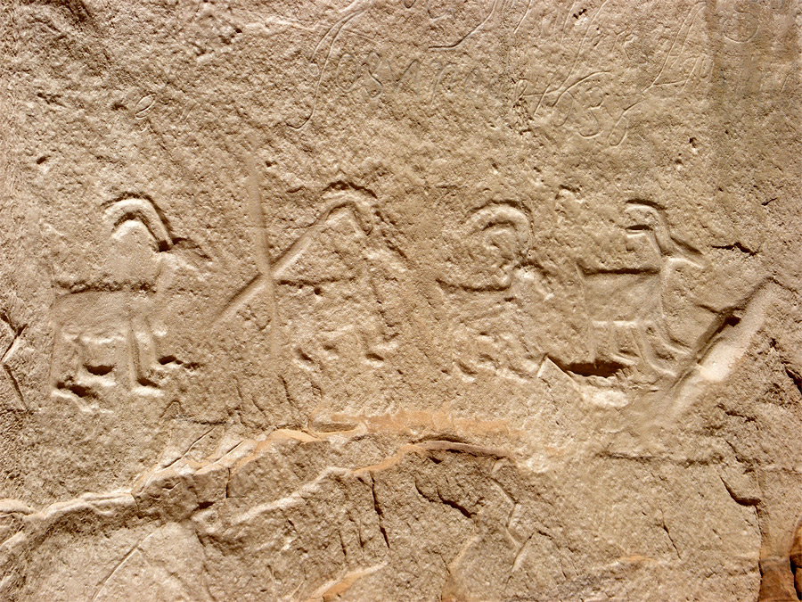 Petroglyphs in sandstone wall