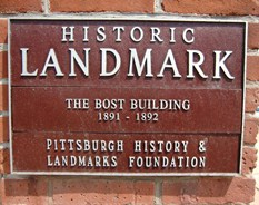 Plaque naming the Bost Building a National Historic Landmark