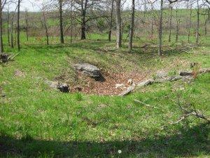 Mass burial sink hole