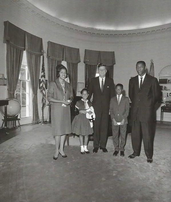 Myrlie, Reena, Darrell and Charles (brother of Medgar) Evers meeting with President John F. Kennedy in the Oval Office after Medgar's death.