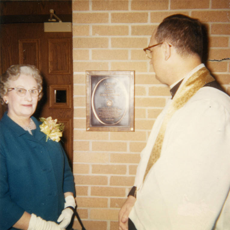 "Mrs. Charles Cobeen poses with Rev. John P. Raynor, S.J. at the dedication of Cobeen Hall, 1966 (""Department of Special Collections and University Archives, Marquette University Libraries, MUA_CB_01104)"